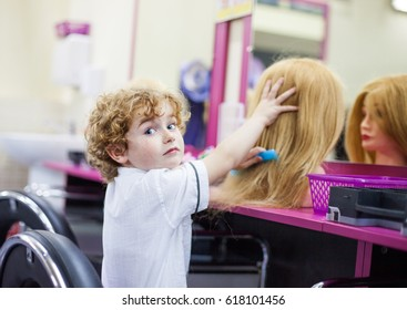 boy hairdresser, day of choice of profession, play at the hairdresser in the children's beauty salon, hairstylist, hairdressing, barber job