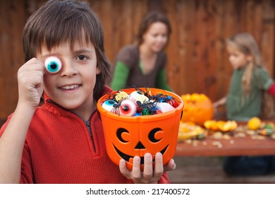 Boy with Halloween stuff preparing for the fright night