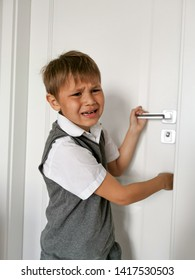 boy hand or finger pinched by the door; close up portrait of finger pinched, slammed by the door, home accident concept