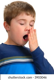 Boy with hand to mouth to cover yawn, isolated on white