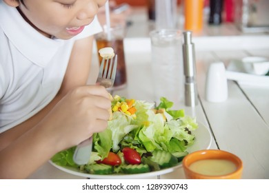 Boy happy ready to eat vegetable salad - people with clean fresh healthy food concept