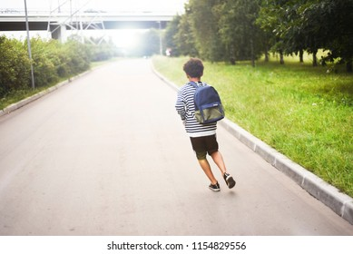 Boy happy running to school with his backpack. Schoolboy on his way to the home after school. Mixed african American boy.