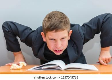 boy has difficulties in homework