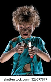 Boy has a electric shock on dark background