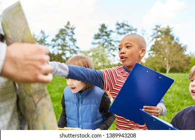 Boy has an idea as a clever detective on the scavenger hunt as a game of terrain in the park