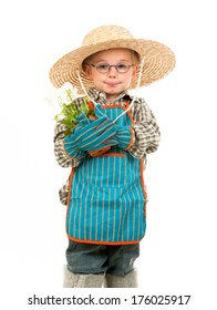 A boy with a hat holding a plant.