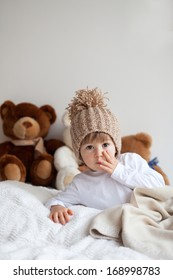 Boy with hat and teddy bears