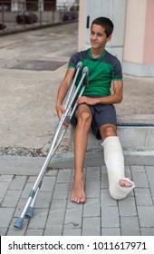 Boy have his leg broken. Gypsum foot