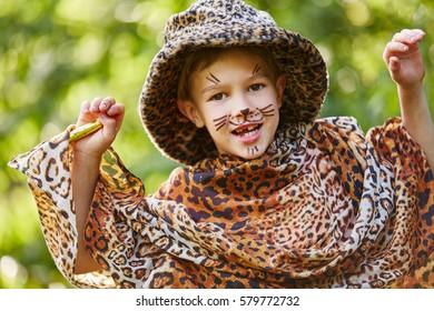 Boy having fun in children's theater dressed up like leopard