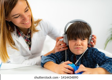 Boy Having a Hearing Exam in the Audiologist's Office