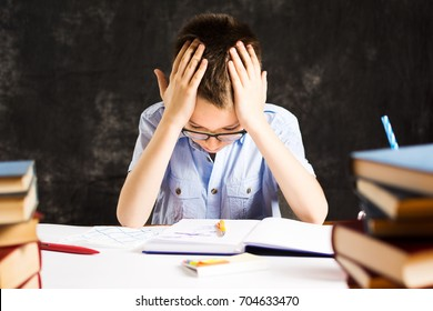 Boy having problems in finishing homework at home