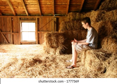 Boy in hay loft looking down