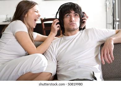 Boy in headphones with girl