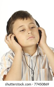 Boy with headphones listening to music over white