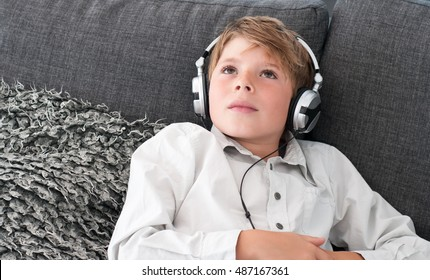 Boy with headphones on the couch