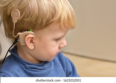 A Boy With A Hearing Aids And Cochlear Implants