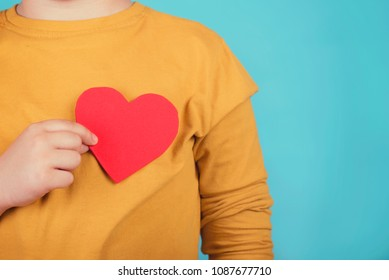 boy with a heart on blue background