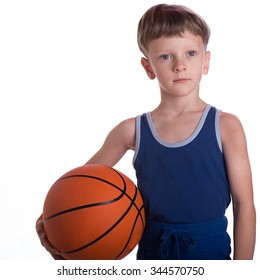 The boy held a basketball ball to a hip an one hand