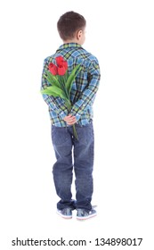 boy hiding flowers of red tulips behind itself, isolated on white background