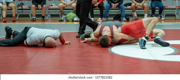 Boy High School wrestlers competing at a wrestling meet