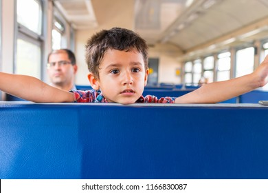 boy with his dad riding on the train