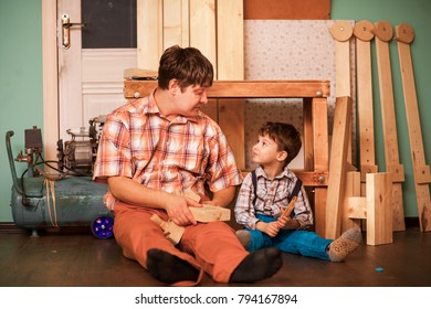 A boy with his father working in the Studio.
