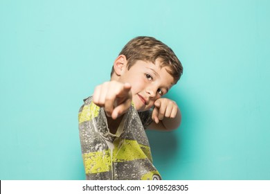 Boy with his fingers pointed at the camera. Child with positive expression