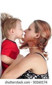 boy and his mother look at each other