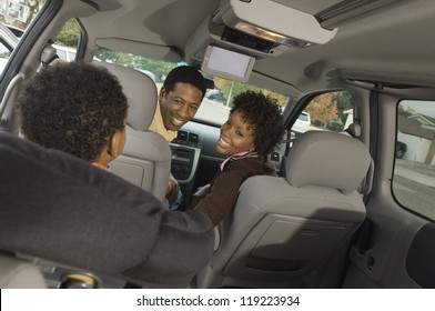 Boy and his parents in a minivan