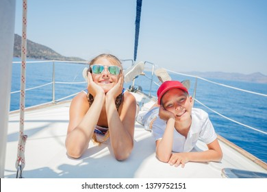 Boy with his sister on board of sailing yacht on summer cruise. Travel adventure, yachting with child on family vacation.