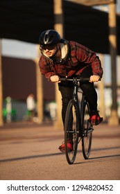 """A boy with his urban bicycle """"fixie"""""""