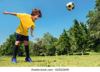 Boy Hits a Soccer Ball With Head in the Park