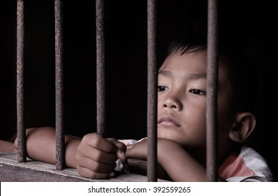 Boy hold cage with eye sad and hopeless