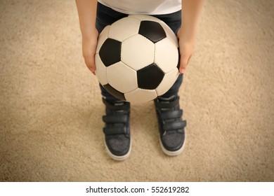Boy holding ball for soccer football