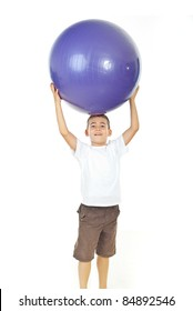 Boy holding big mauve ball over his head isolated on white background