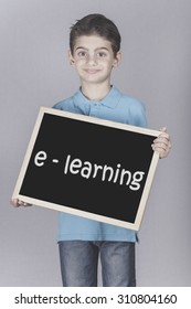 Boy holding a blackboard with e-Learning message. Cross processed image