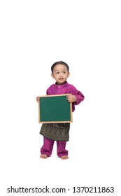 Boy holding a blank black board wearing traditional costume