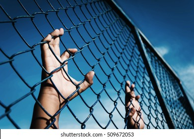 the boy holding the cage sky background , imprisoned, retarded, Child Abuse with black shadow
