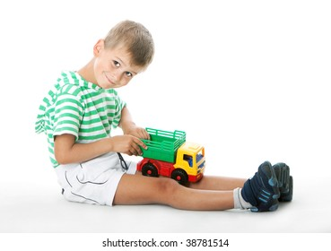 Boy holding a car