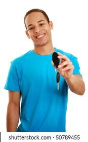 Boy holding car key isolated on white (focus on face)