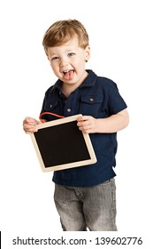 Boy holding chalk board and sticking his tongue out on studio white background.