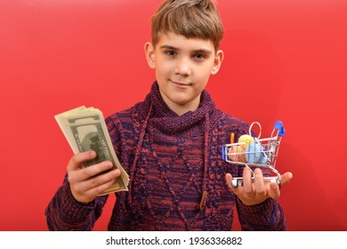 The boy is holding dollars in one hand and Easter eggs in a shopping cart in the other.