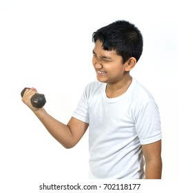 boy holding dumbbell in hand. child face feeling very heavy