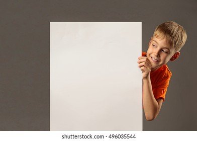 boy holding an empty poster