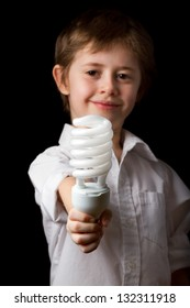 Boy holding a energy saving lamp
