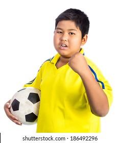 A boy holding football glad