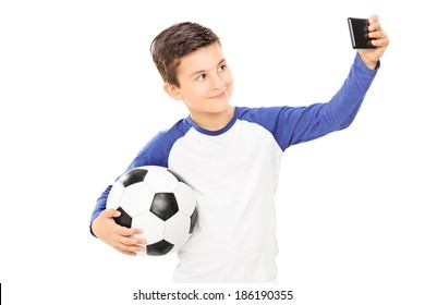 Boy holding football and taking a selfie isolated on white background