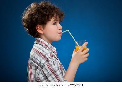 Boy holding glass of orange juice