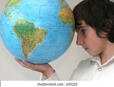 Boy holding the globe