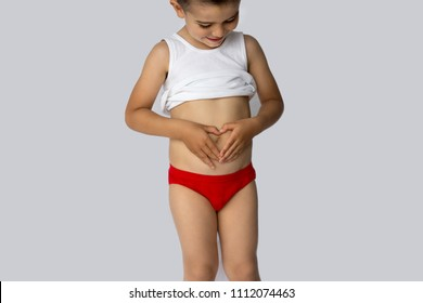 the boy is holding his hands on his tummy. the belly of a child. stomach